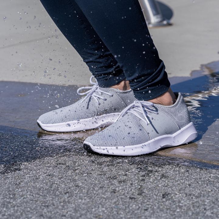 Model wearing the shoes in Mist Grey