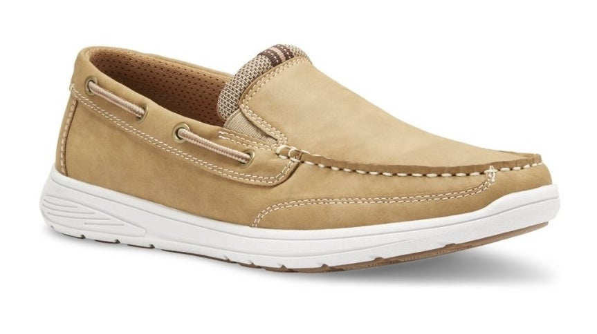 Tan slip on shoe with white stitching and white sole