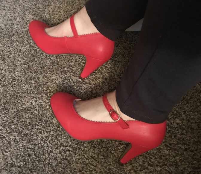 a reviewer wearing the mary jane styled pumps in red