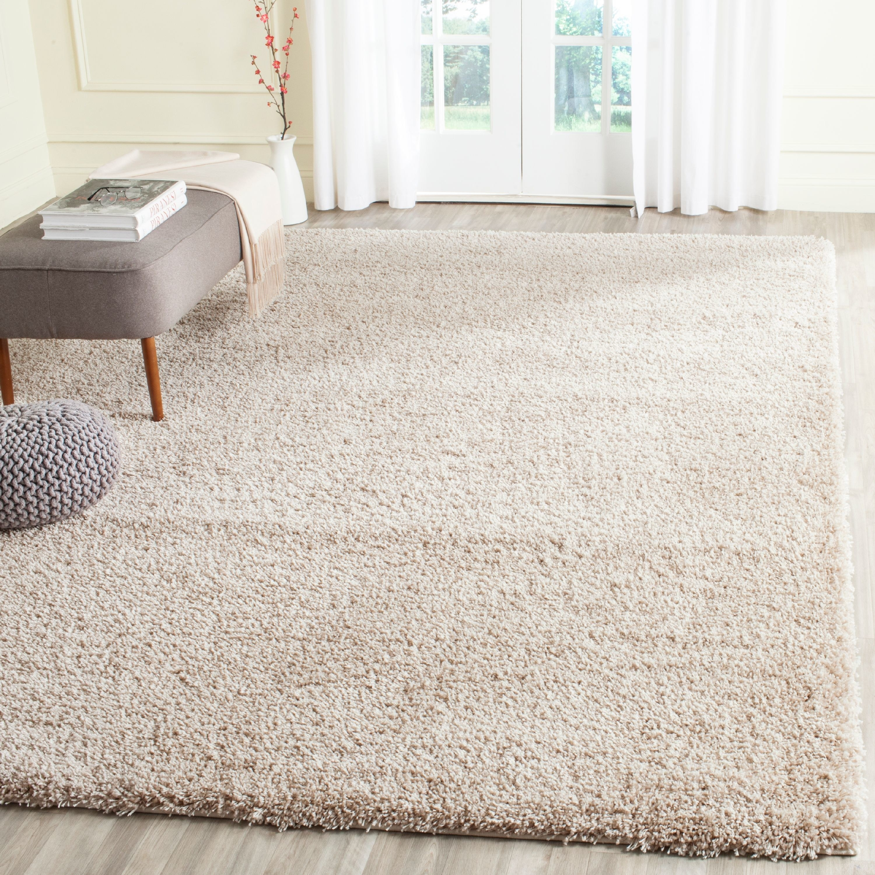 The area rug laid out in a room in beige