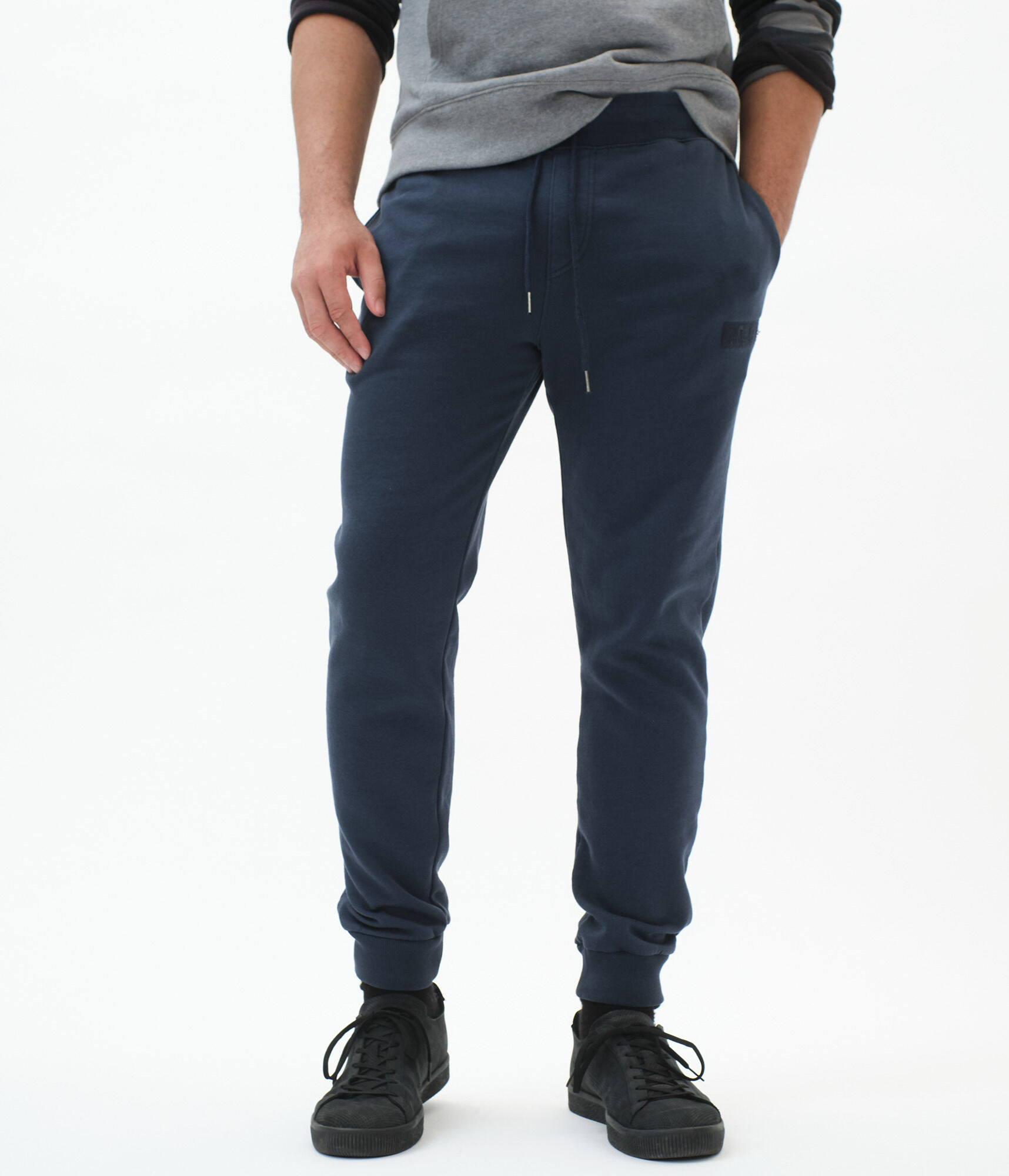 model wearing navy jogger sweatpants