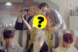An image from TXT's music video for Can't You See Me with a question mark over Hueningkai's head
