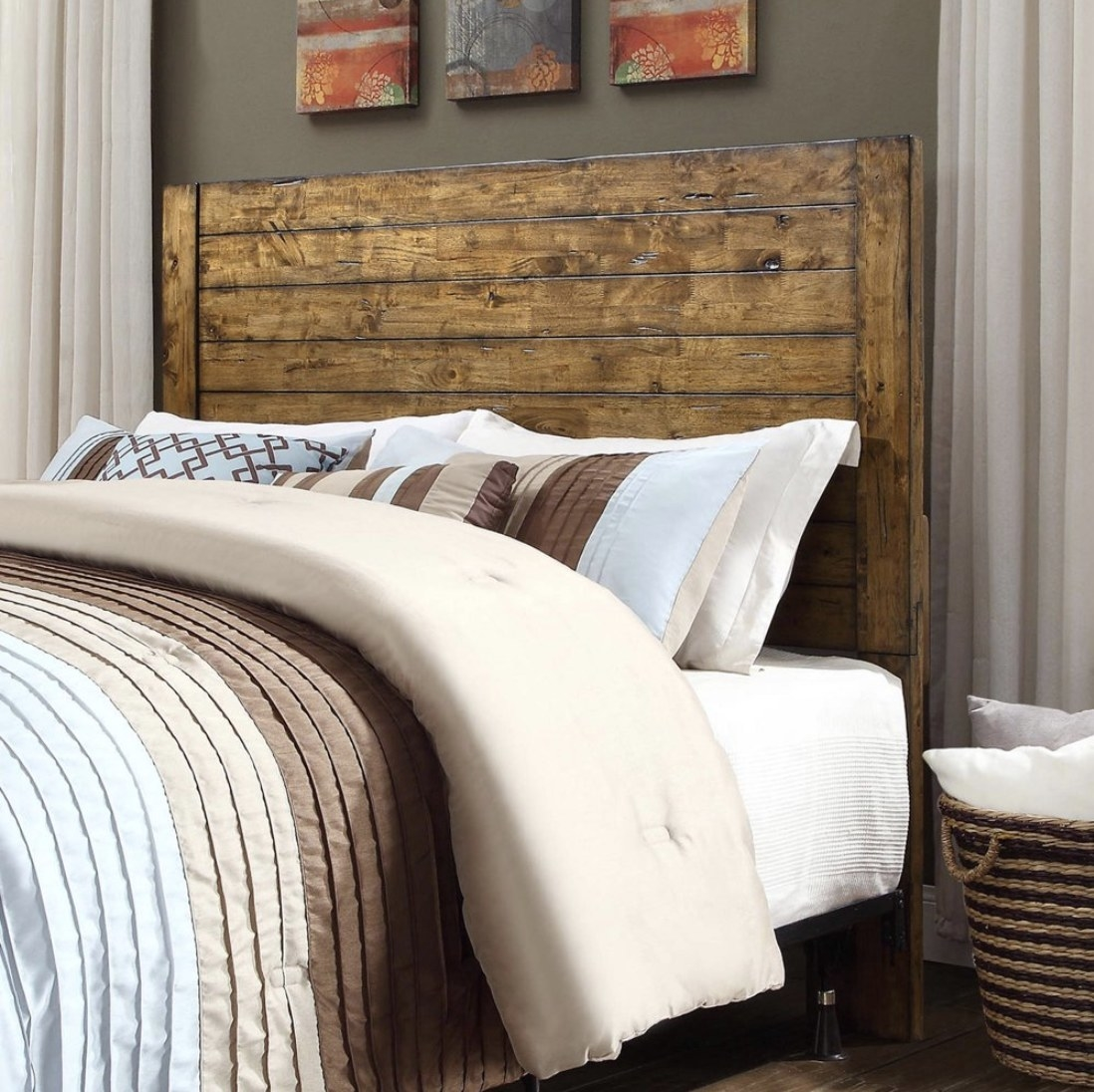 A rustic wood headboard installed behind a bed in a bedroom