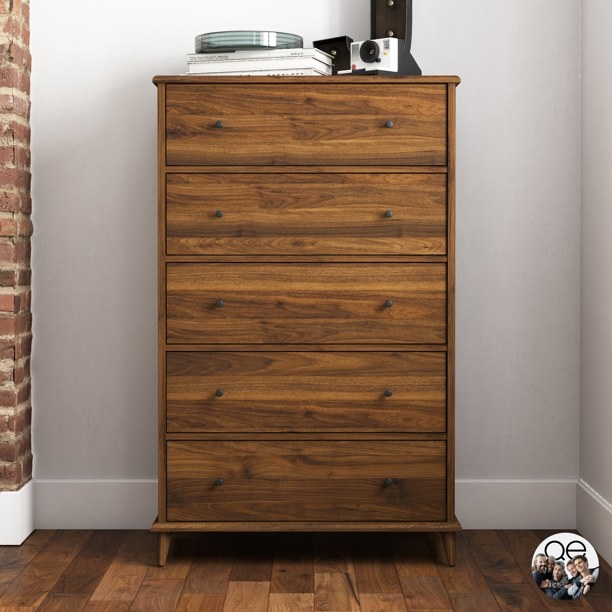 The dresser in a modern room with wooden flooring.
