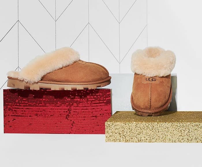 the tan slippers with a hard bottom and a furry lining around the edge