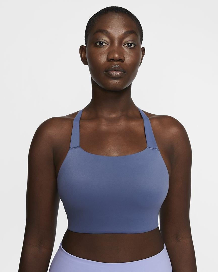 Model wearing the Nike Swoosh Luxe bra in blue