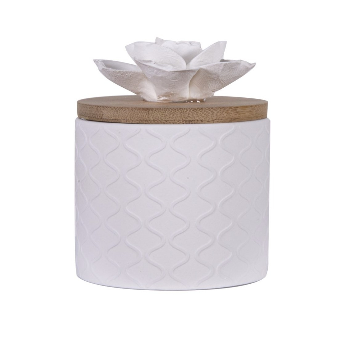 A white ceramic diffuser with a ceramic flower on top