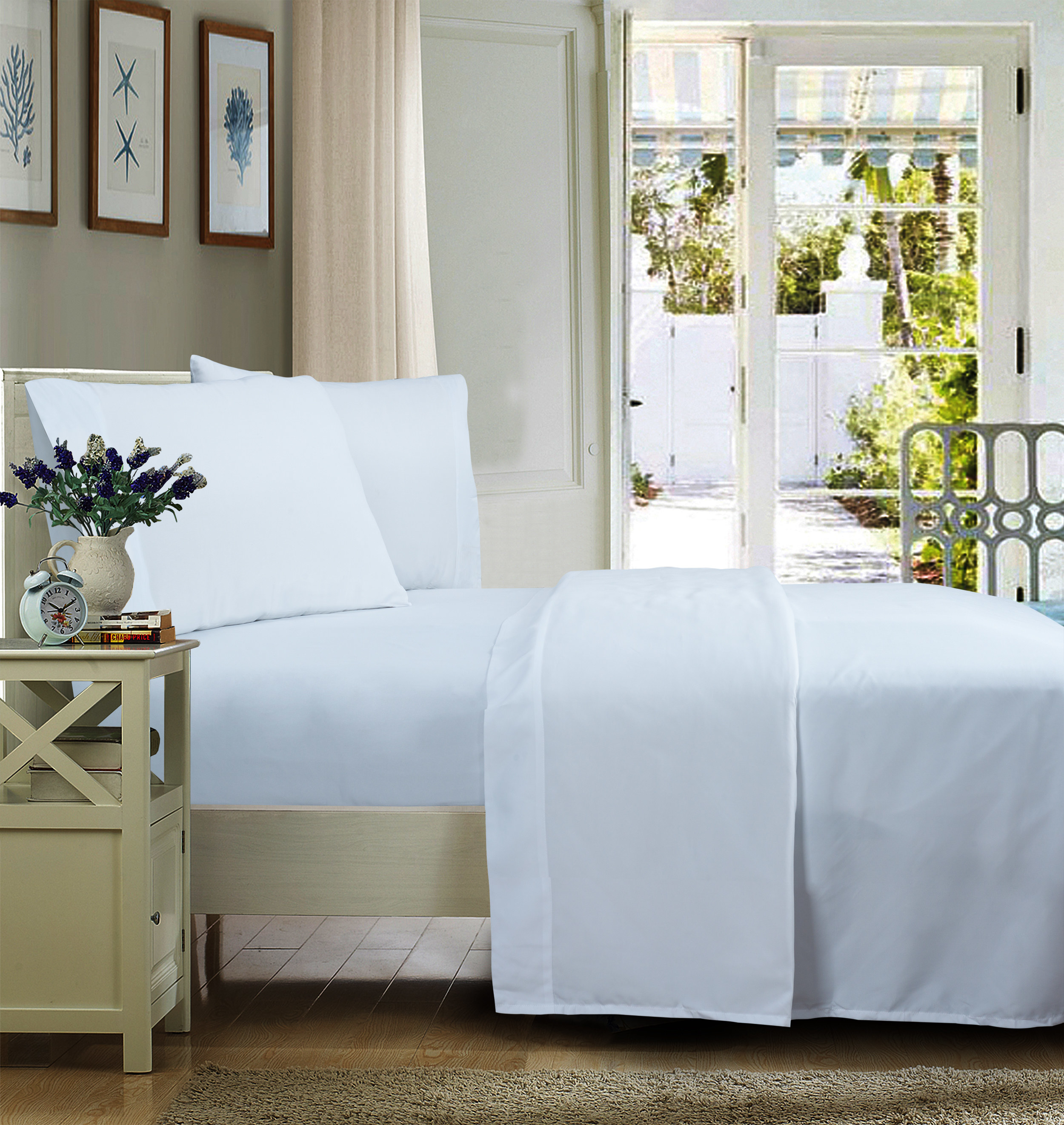 The sheets on a clean, white bed