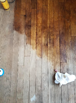 Reviewer's dull, almost white wood floors looking fresh, dark, and new where polish has been applied