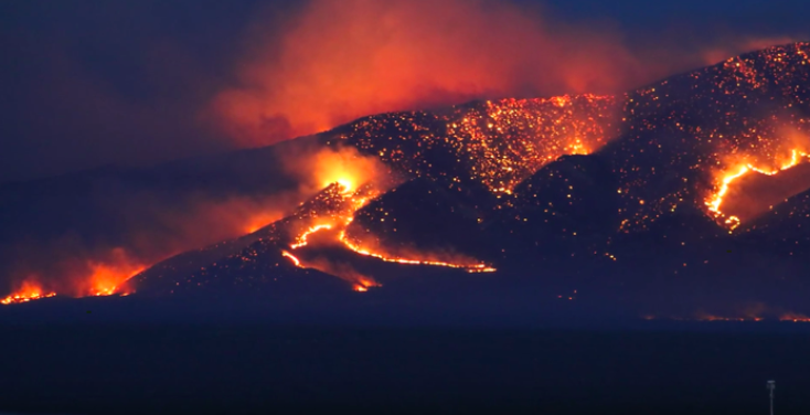 Fire engulfs a mountain