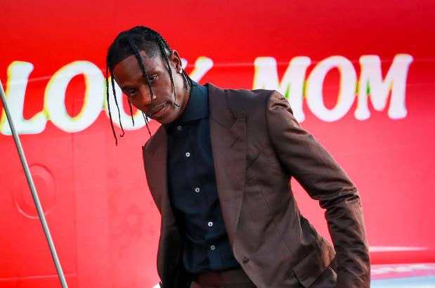 Travis Scott poses outside a private jet