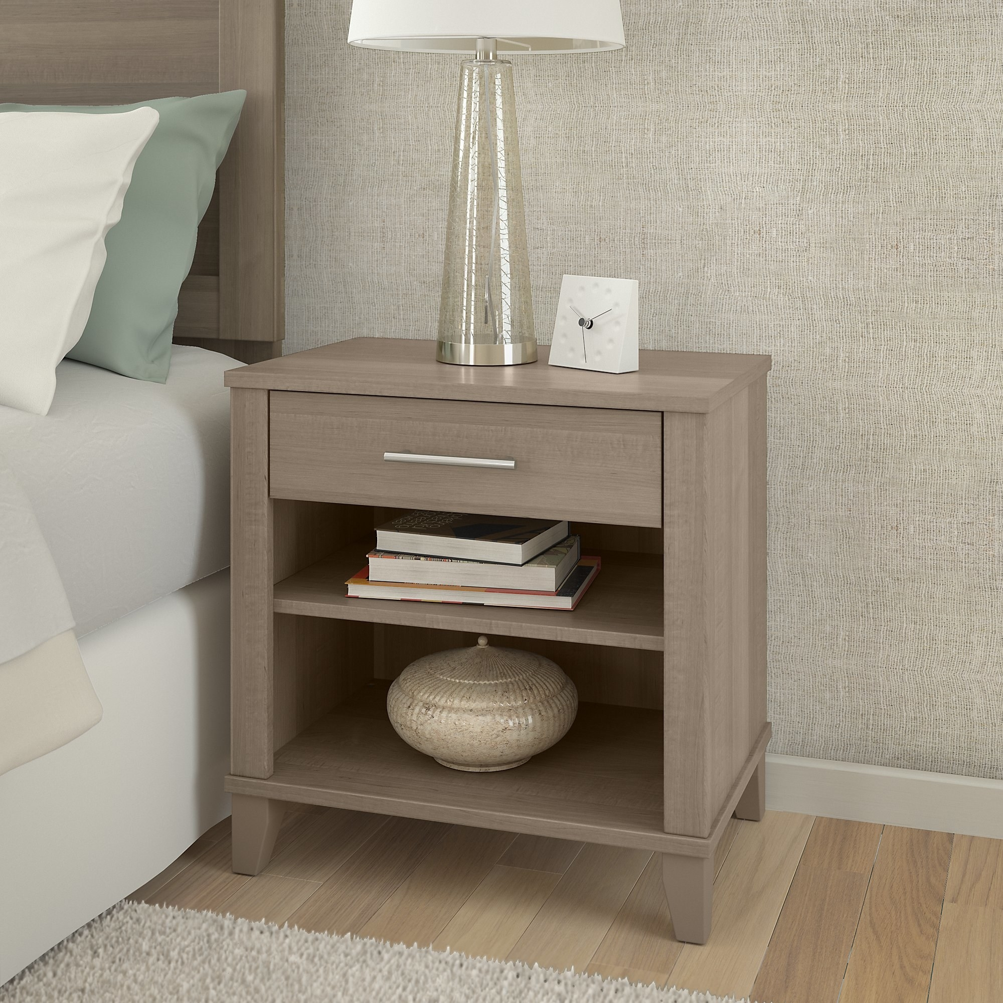 The nightstand with two open shelves and one closed shelf