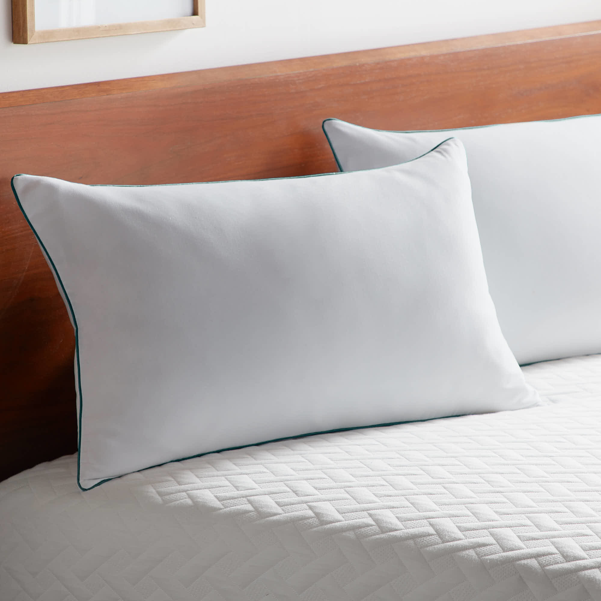 Two memory foam pillows on top of a mattress.