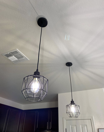 Different reviewer image of a closeup of the pendant lights
