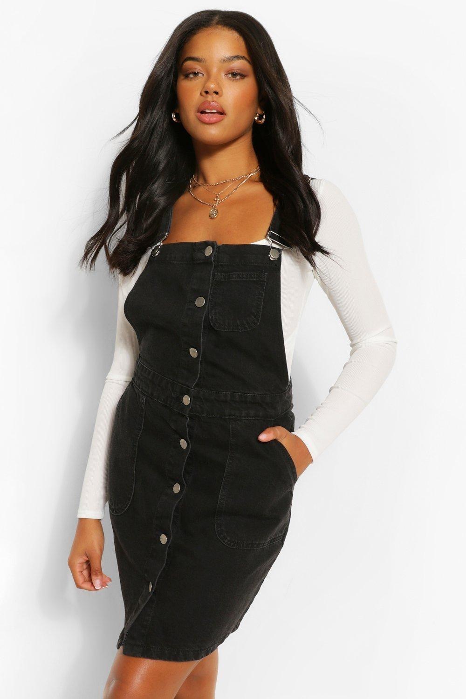 Model in black denim overall dress