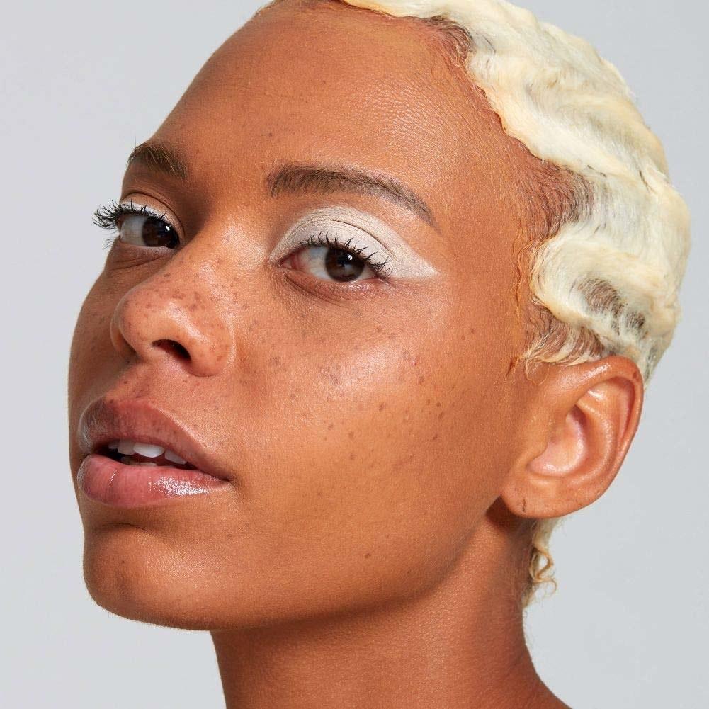 model wearing white eyeliner on their eyelids