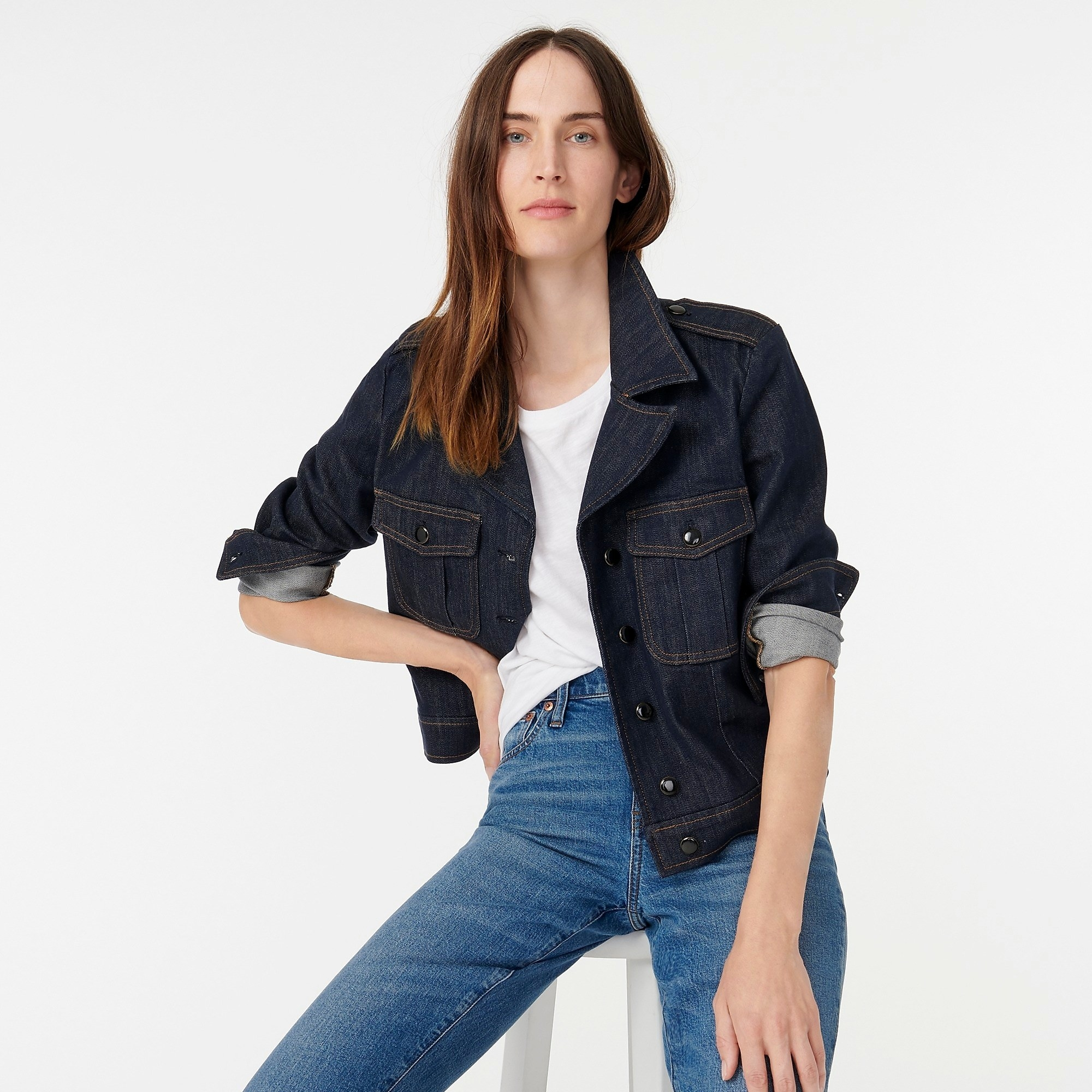 A model wearing the jacket with the sleeves pushed up to their elbows