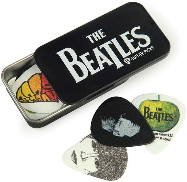 A tin pick holder with The Beatles' logo on it partially open and a variety of Beatles picks