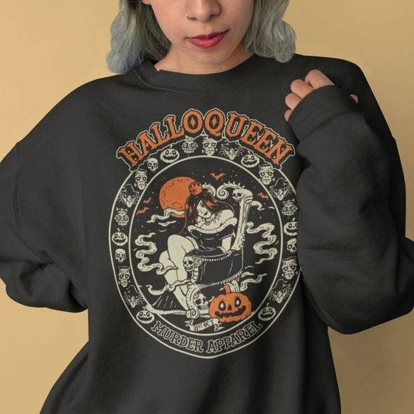 model wearing black sweatshirt that says Halloqueen on it with a jack o lantern design