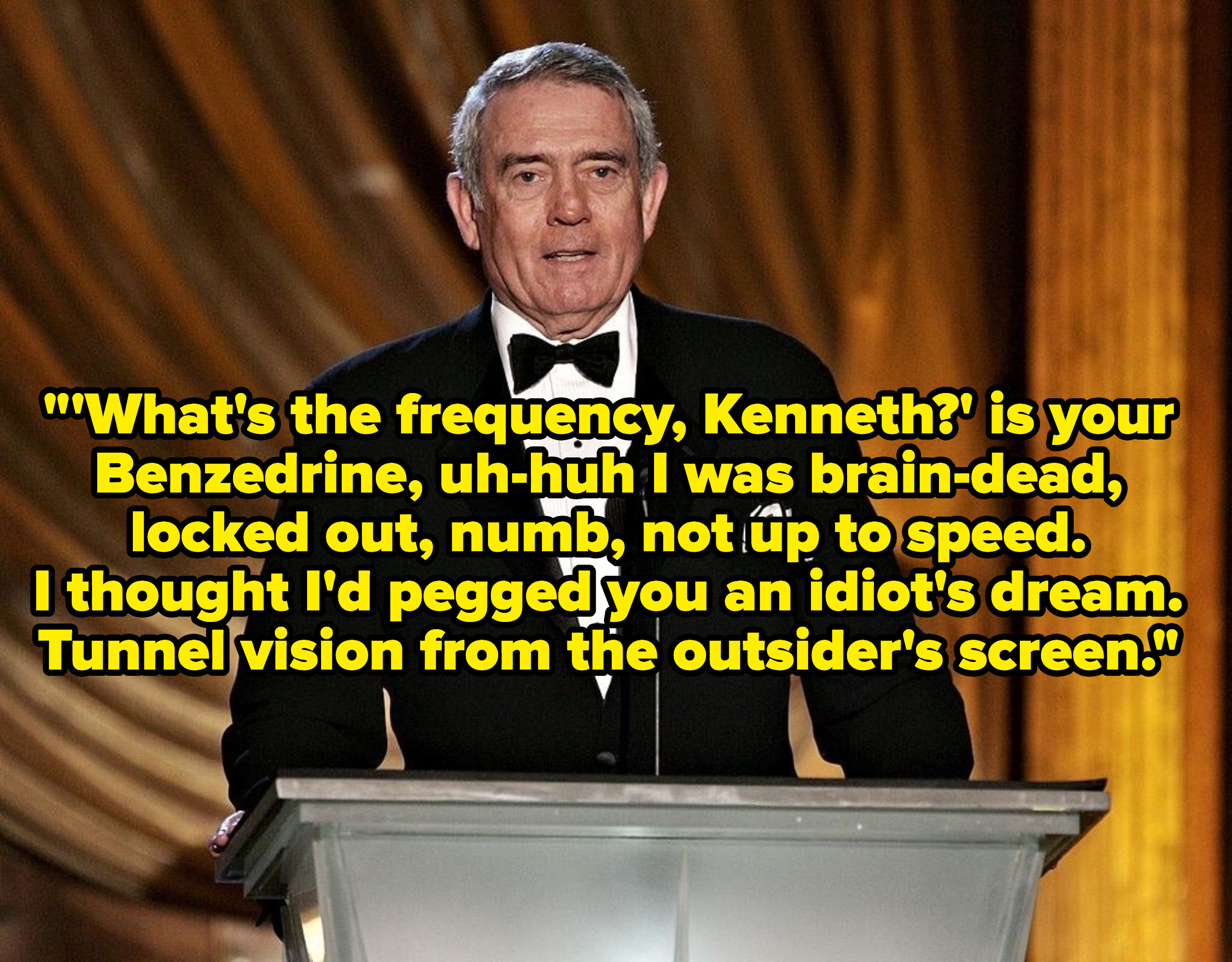 Dan Rather speaking at a podium, captioned with the lyrics to the song.