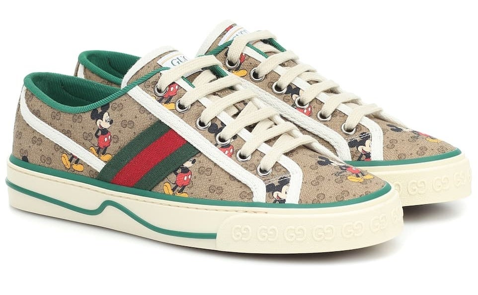 tan tennis shoes in the classic gucci print with off white laces, green and red stripes along the sides and mickey throughout