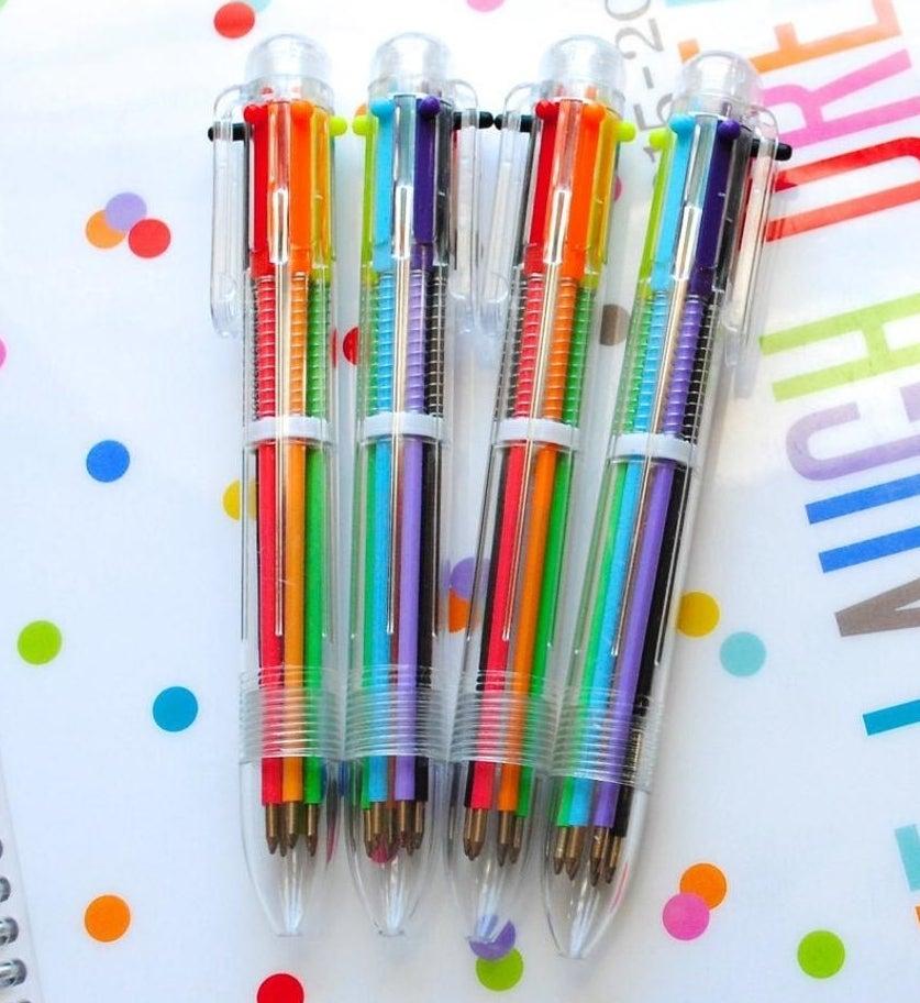 Four multi-colored pens in clear plastic