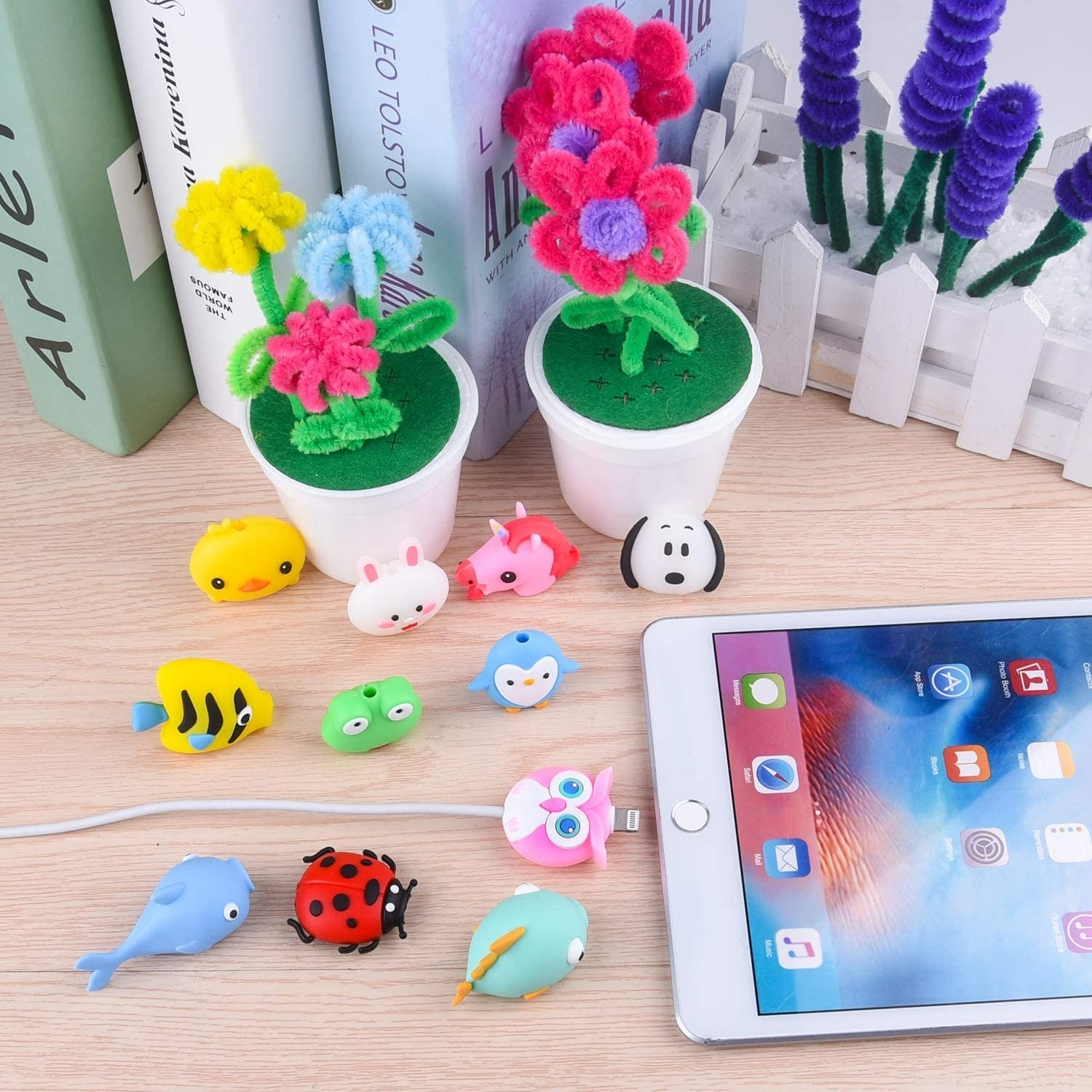 "The owl around the ""neck"" of a tablet charger to keep it straight, plus other animals including a unicorn, chick, ladybug, fish, and penguin"