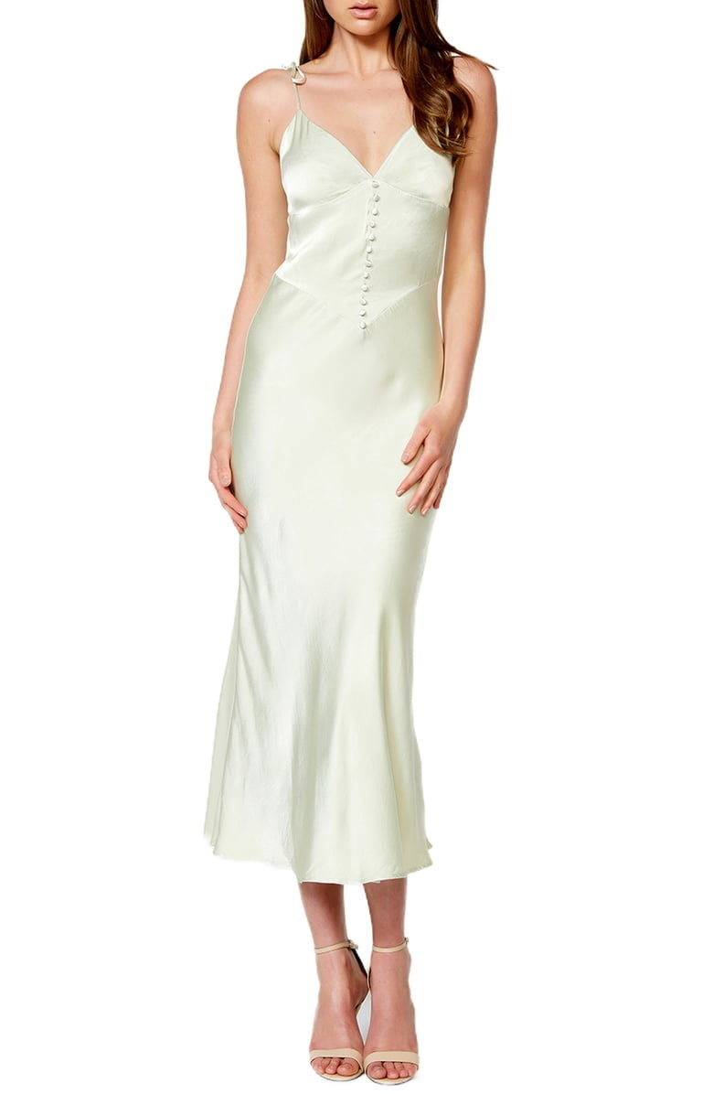 The white, tie-shoulder midi slip dress with button details on the bodice
