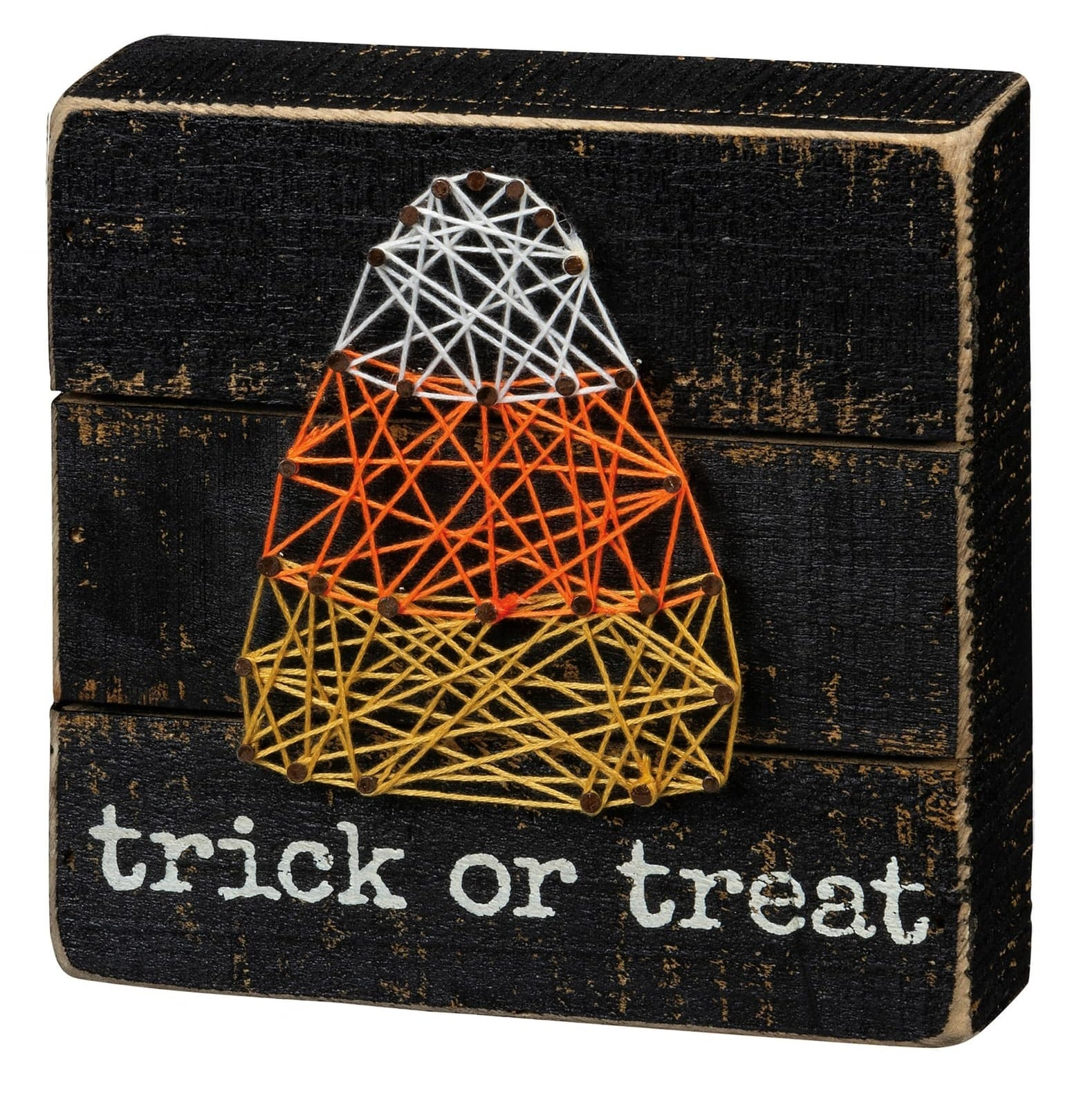 The black box sign says trick or treat in white letters and features a candy corn string art design
