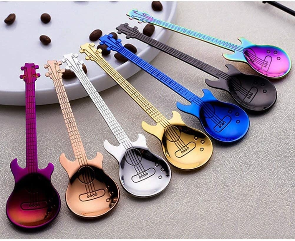 Seven guitar spoons showcasing each of the colors included