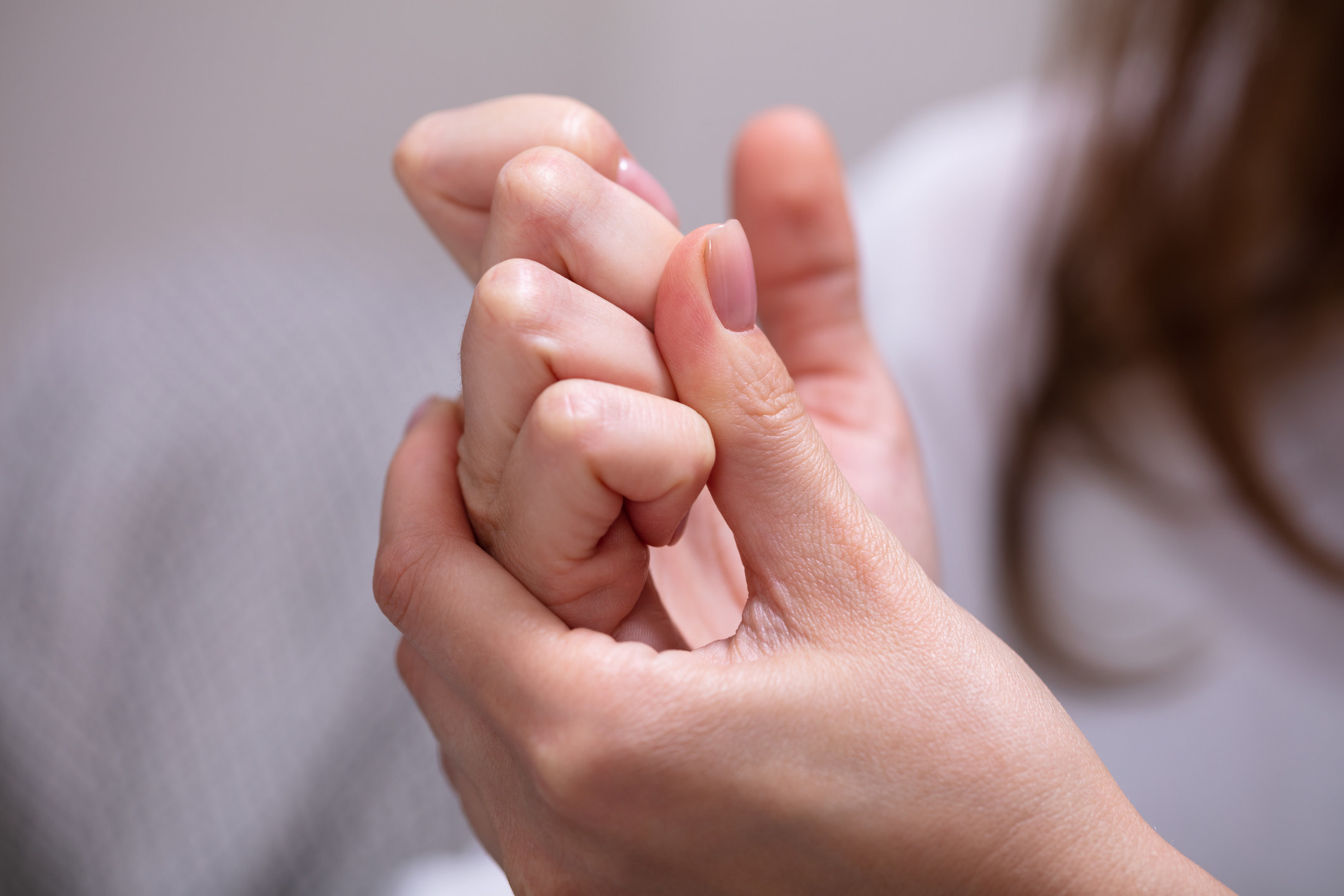 A person cracking knuckles