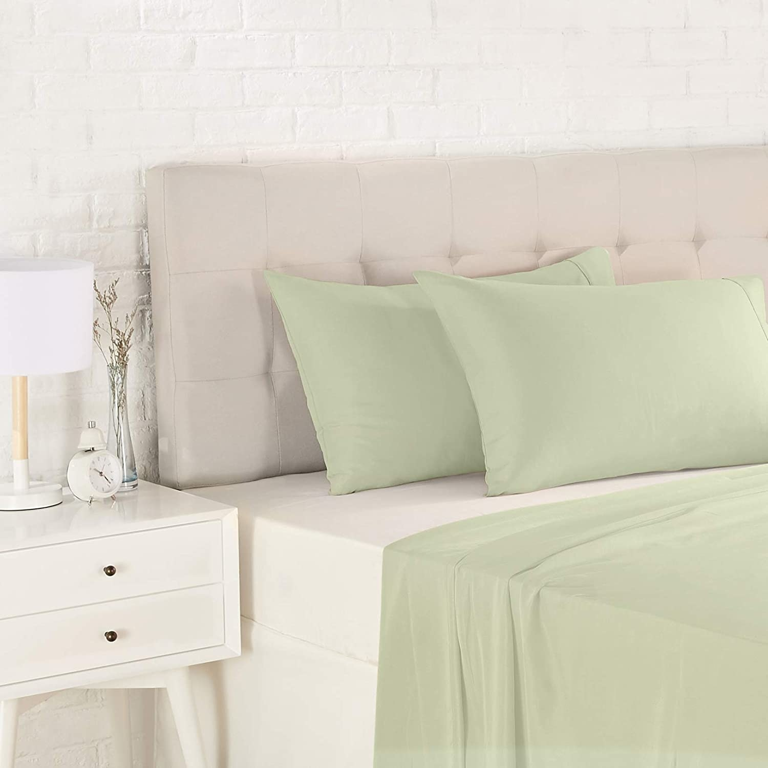 The pillowcases in light sage green