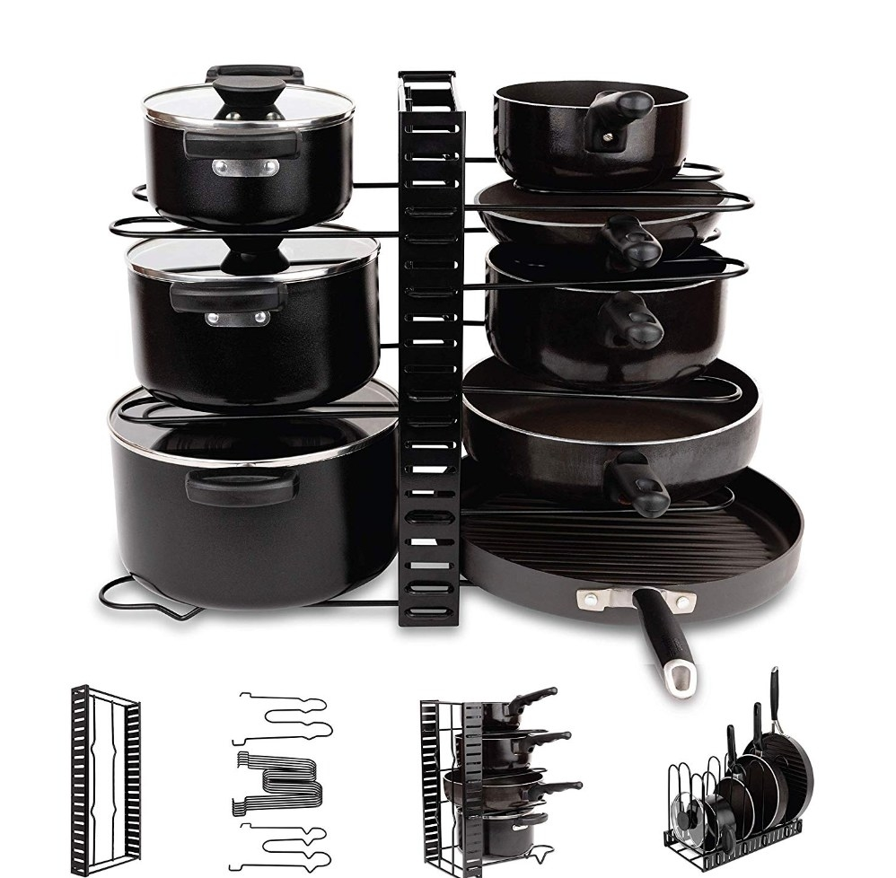The black cookware organizer holding sets of hots and pans with lids