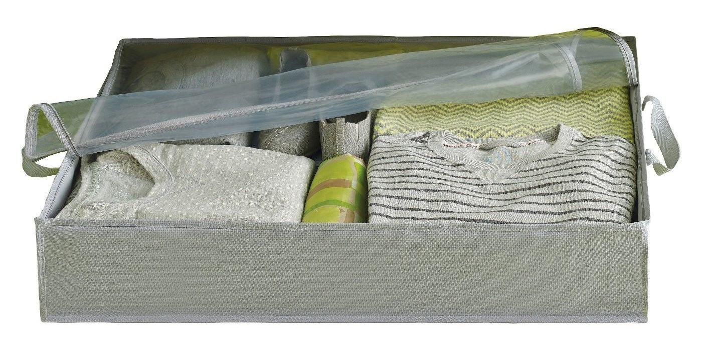 Gray storage box with clothes inside