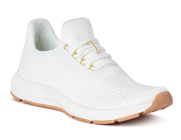 White fabric running sneakers with tan bottom