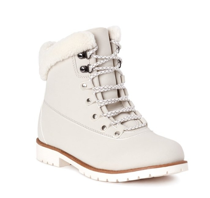 Cream colored boot with white laces and fur trim