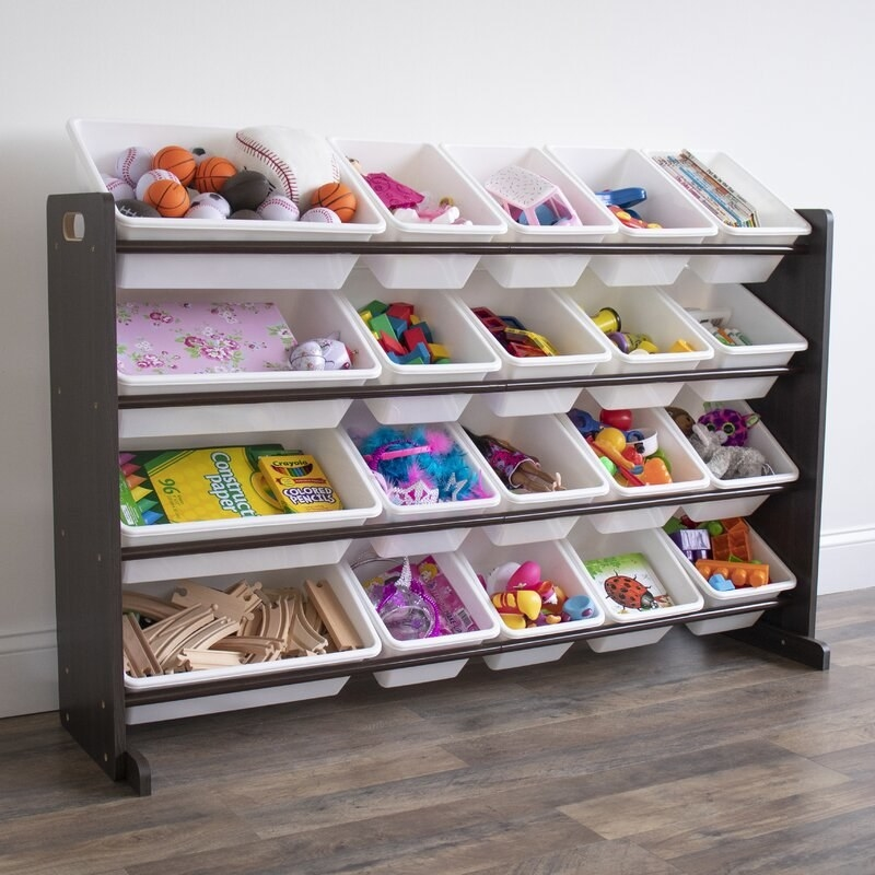 A white and dark brown toy organizer holding various toys