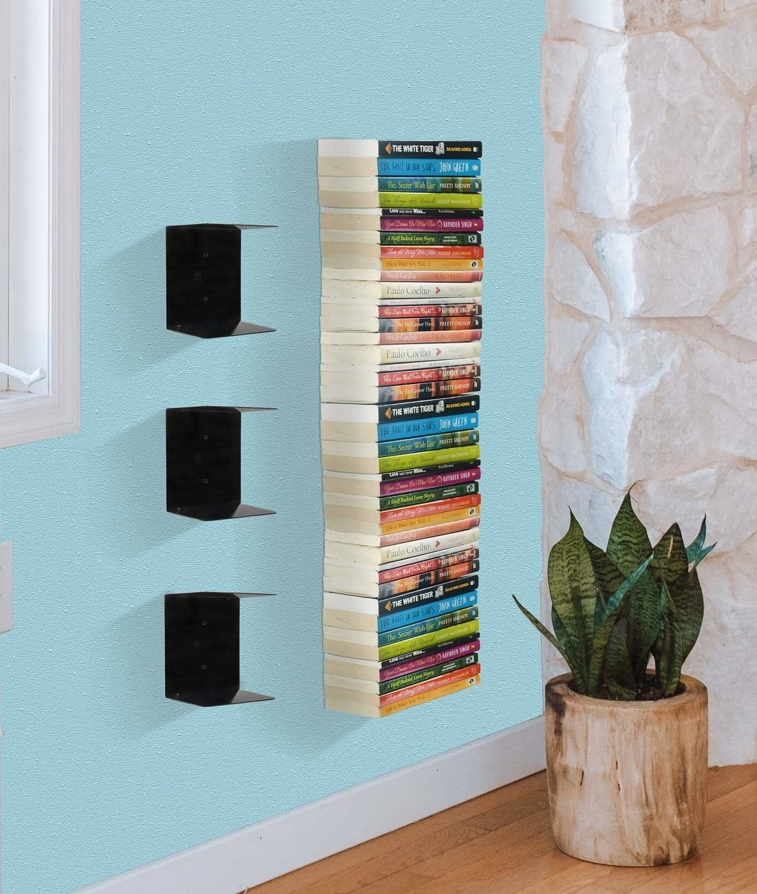 Three metal bookshelves with a top and bottom surface each, pictured with books on them.