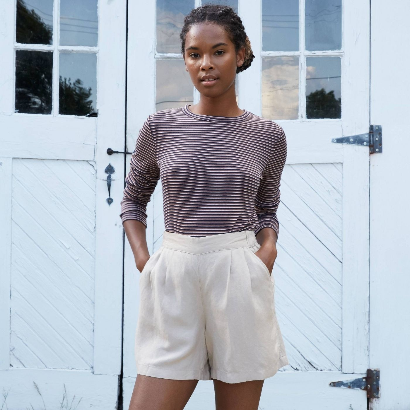 Model in striped long sleeve t-shirt and shorts