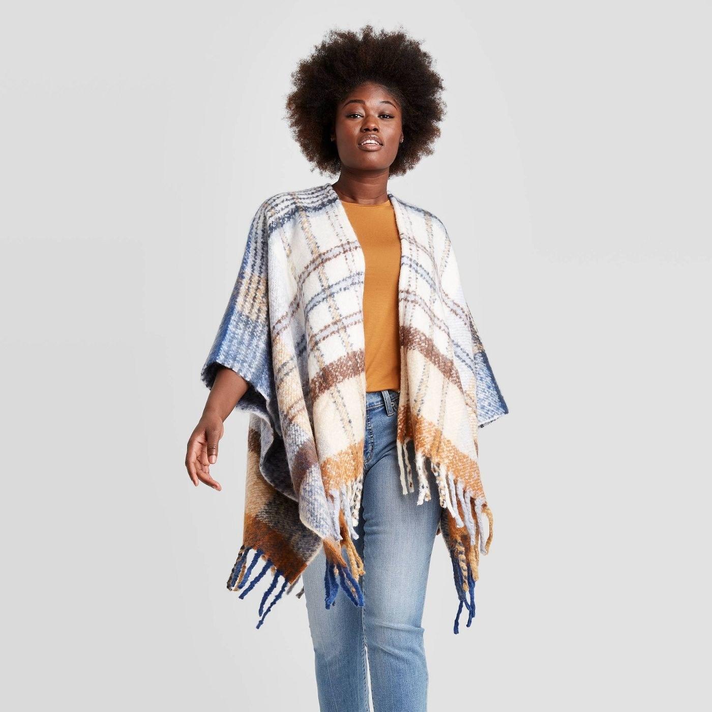 Model in plaid poncho jacket