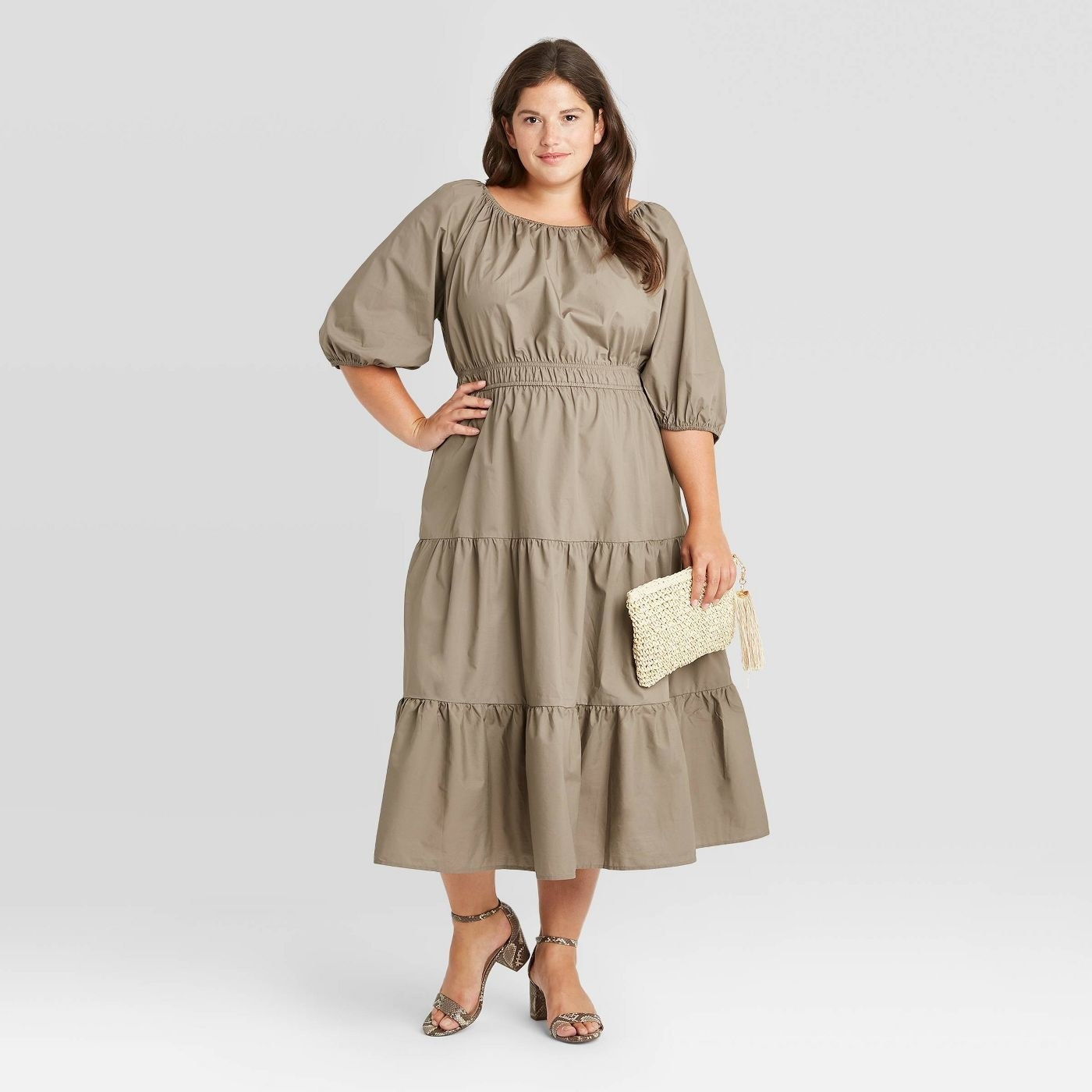 Model in tiered puff sleeve dress