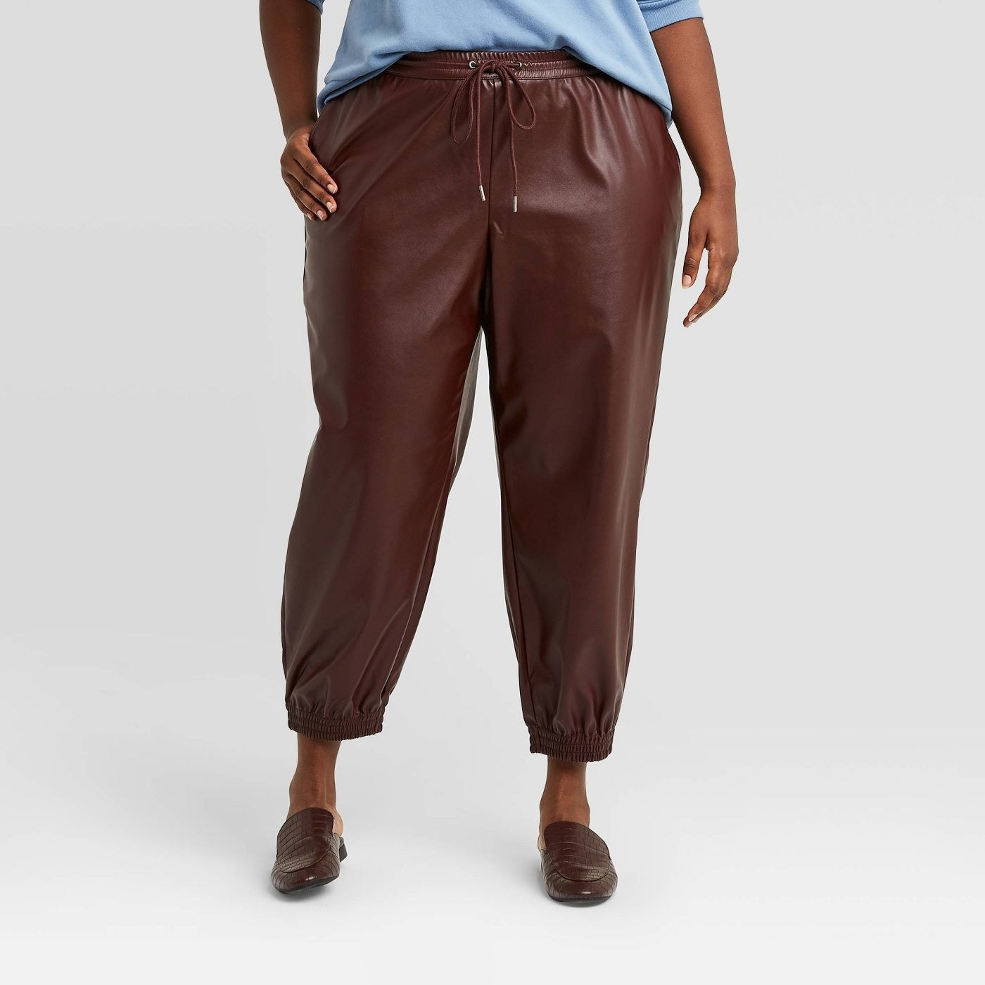 Model in faux-leather jogger pants