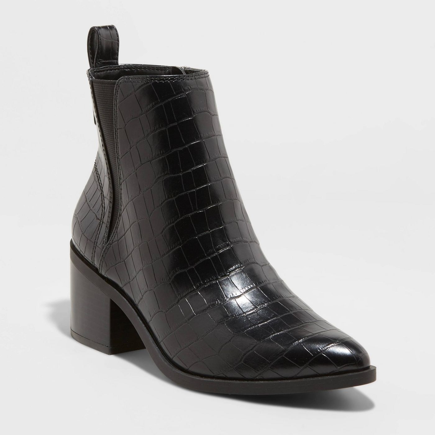 A pair of croc pointed to heeled black chelsea boots