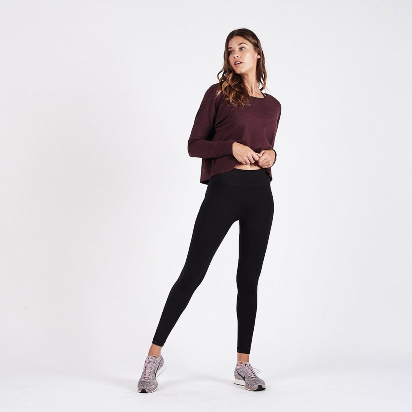 Person wearing high waisted black leggings that hit above ankle