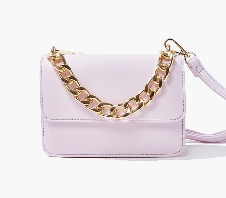 The square crossbody bag with flap-top closure, shoulder strap, and gold chain top handle