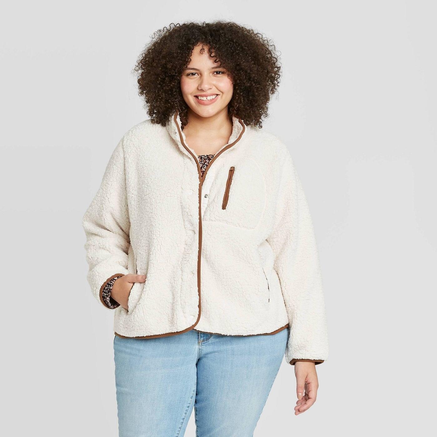 model in high-neck sherpa jacket