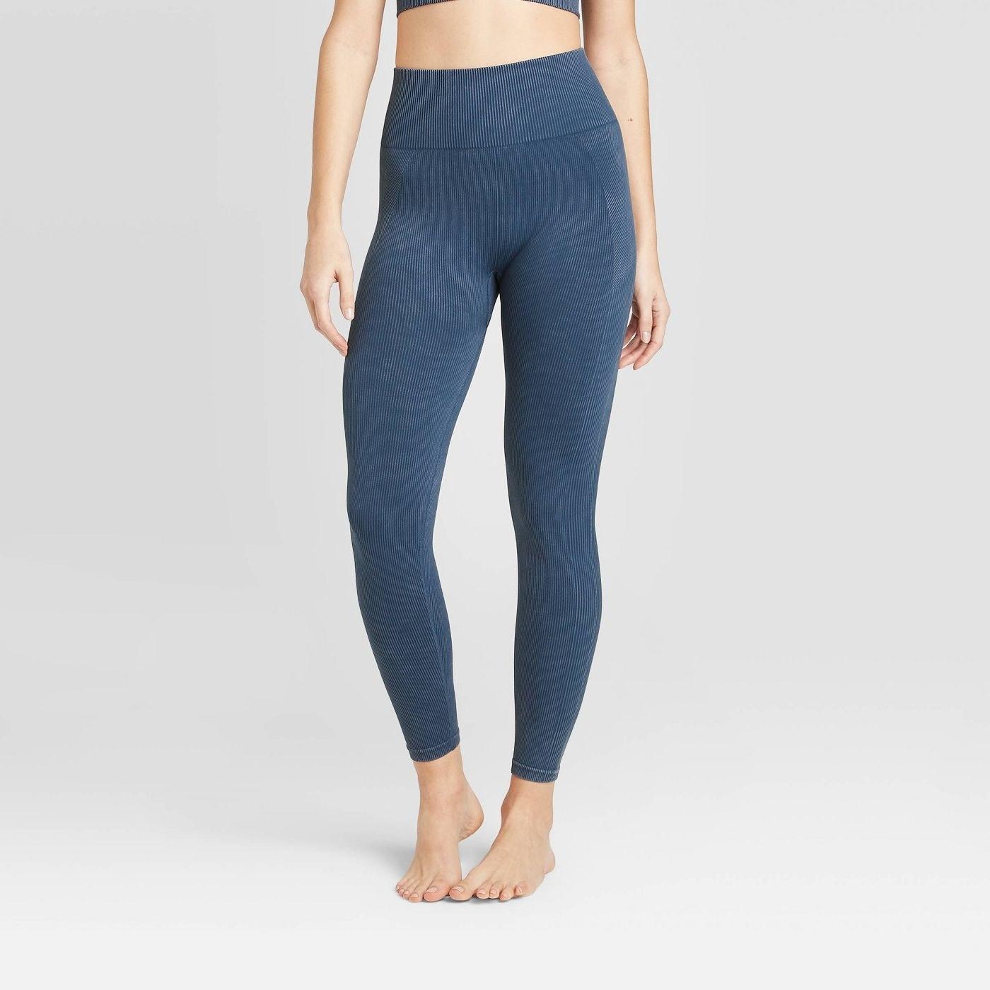 Model in blue seamless ribbed leggings