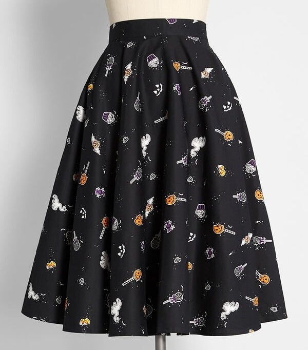 The black mini skirt on a mannequin with a print of various Halloween treats like cake pops and cupcakes