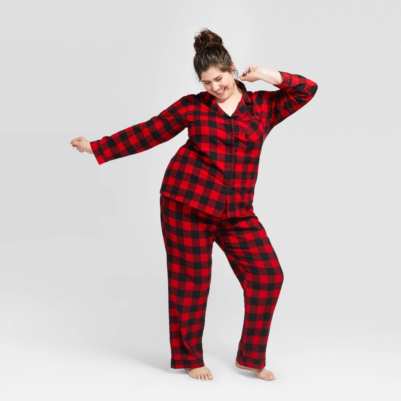 Model in buffalo check flannel pajamas