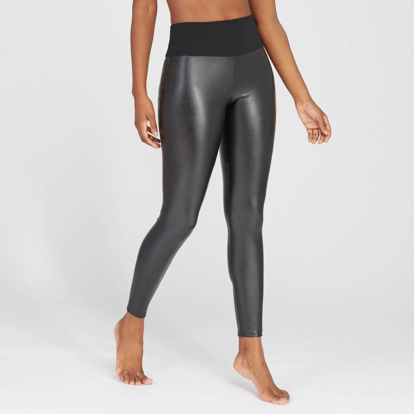 Model in black faux leather leggings
